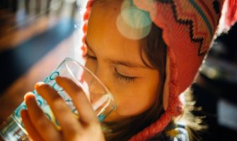 girl drinking water glass