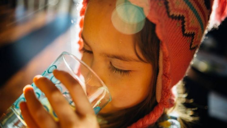 girl drinking water glass